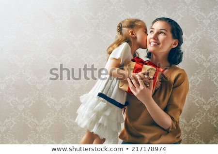 daughter giving present to mother on christmas stock photo © dolgachov