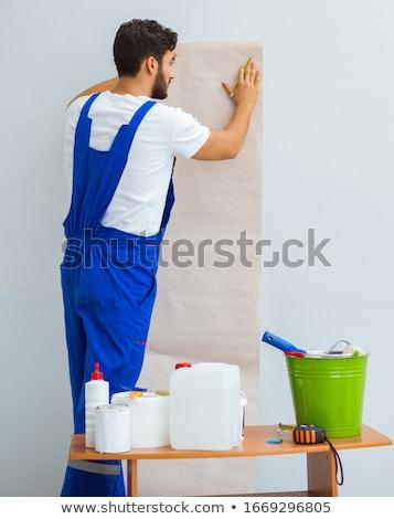 Worker working on wallpaper during refurbishment Stock photo © Elnur