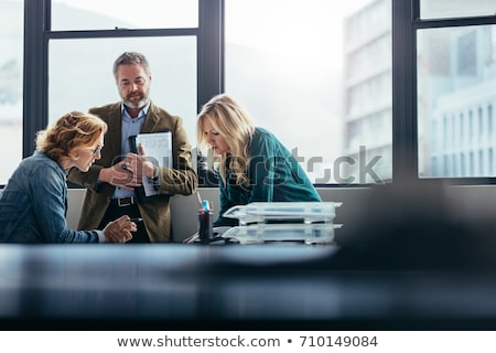 Team of Business People Discussing Construction Plans Stock photo © pressmaster