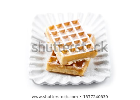 Belgium waffers with sugar powder on ceramic plate isolated on w Stock photo © marylooo