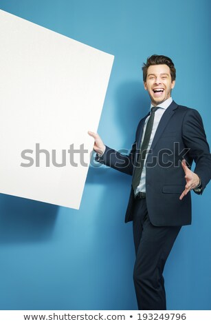 Smiling friendly man holding blank signboard.  Stock photo © lichtmeister