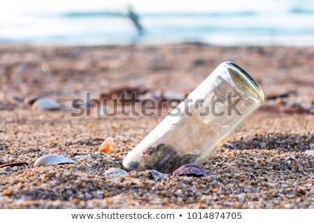 бутылку сообщение письме пляж СОС Сток-фото © Illia
