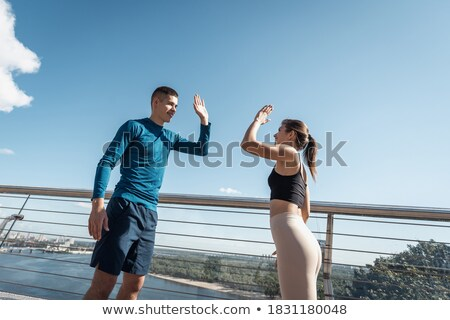 Hands of two successful partners in high-five gesture after making agreement Stock photo © pressmaster