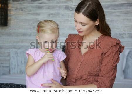 少女 ロリポップ ベッド ピンク 壁 家 ストックフォト © Lopolo