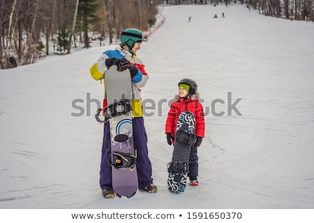 Snowboard instructeur jongen snowboarden activiteiten kinderen Stockfoto © galitskaya