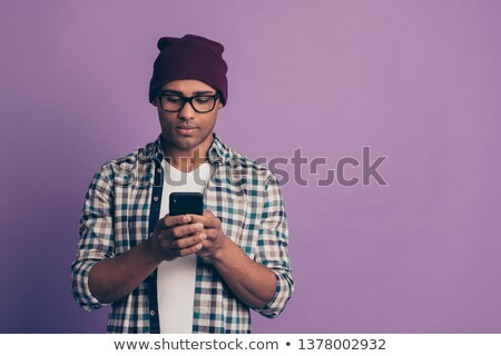 Man in purple shirt on cell phone Stock photo © Hofmeester
