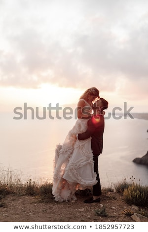 bride and groom kissing at sunset stock photo © photocreo