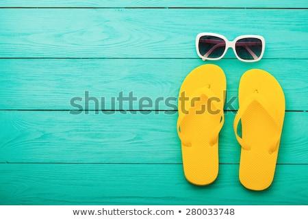 branco · sandálias · óculos · de · sol · praia · amarelo · rocha - foto stock © jagston