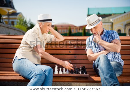 two senior girlfriends playing chess stock photo © photography33