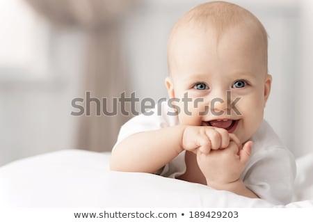 fiú · mosolyog · ágy · kicsi · kisgyerek · évek - stock fotó © zakaz