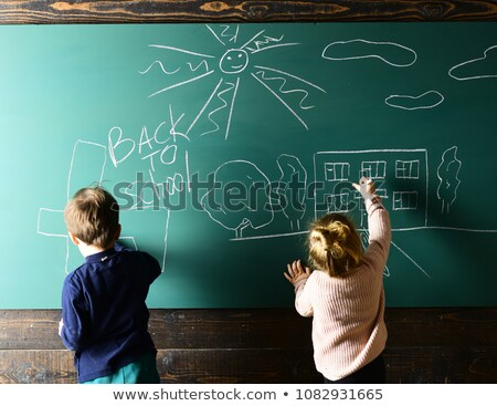 little boy focusing on his work in classroom stock photo © photography33