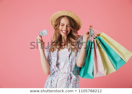 woman in straw hat holding shopping bags stock photo © photography33