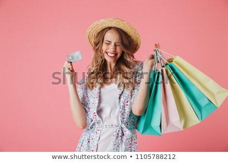 boldog · nő · fekete · napszemüveg · bevásárlótáskák · vásár - stock fotó © photography33