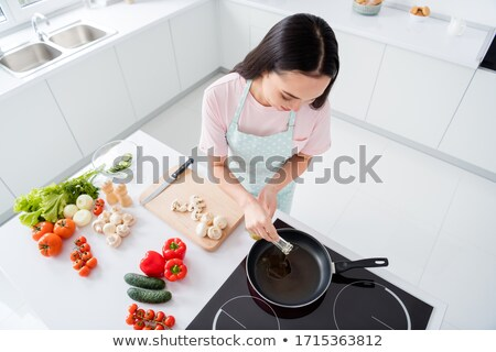 Woman using griddle Stock photo © photography33