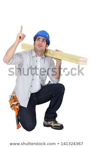 ács térdel mutat telefon épület férfi Stock fotó © photography33