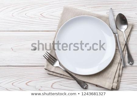 forcella · cucchiaio · coltello · isolato · ristorante · tavola - foto d'archivio © dvarg