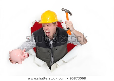 Manual worker smashing piggy-bank Stock photo © photography33