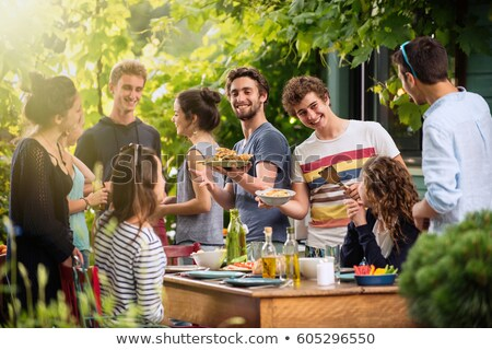 Friends enjoying a barbecue together Stock photo © photography33