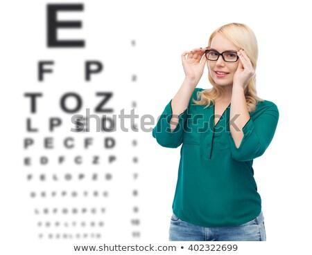 eyeglasses over snellen eye chart stock photo © experimental