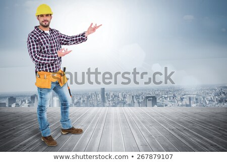 young handyman with a floorboard Stock photo © photography33