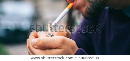 Nervoso homem fumador adulto masculino luzes Foto stock © stevanovicigor