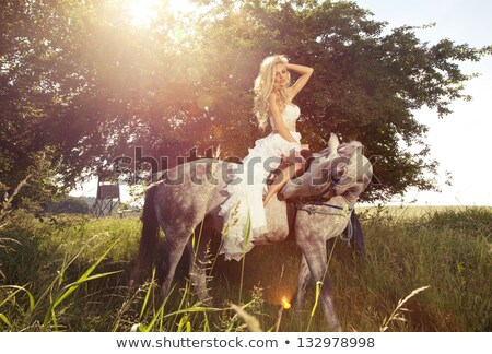 young blonde bride riding a horse in fashionable dress stock photo © pawelsierakowski