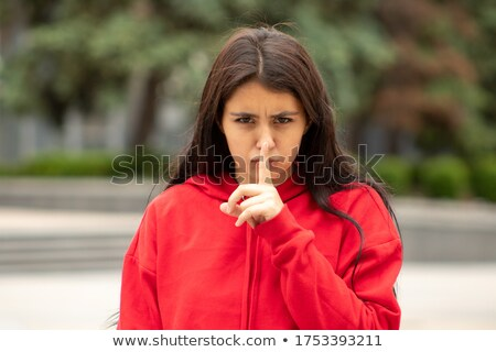 Attractive young woman requesting to you silence Stock photo © pablocalvog