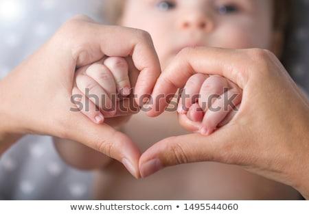 Primer plano bebé mano nino estudio cute Foto stock © luckyraccoon