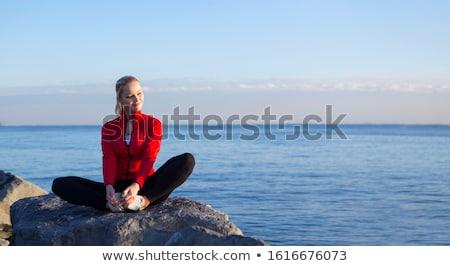 attractive blonde woman posing at the seaside stock photo © konradbak