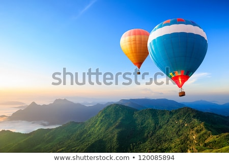 Stock photo: Hot air balloons travel over the sea