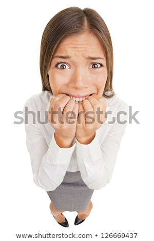 frightened businesswoman biting her fingers Stock photo © dolgachov