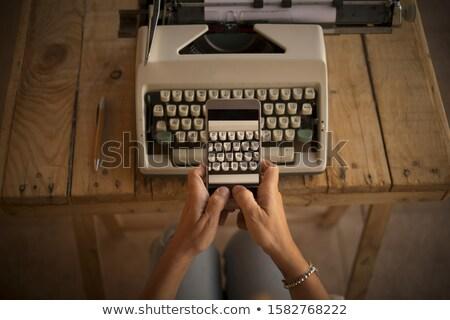 wifi on old typewriters keys stock photo © tashatuvango