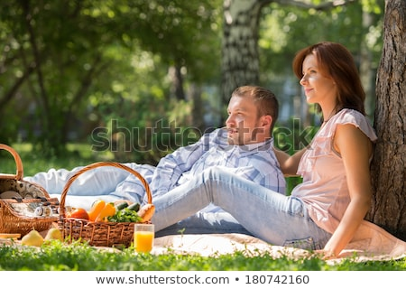 adult couple picnicking in the summer park under the tree stock photo © hasloo