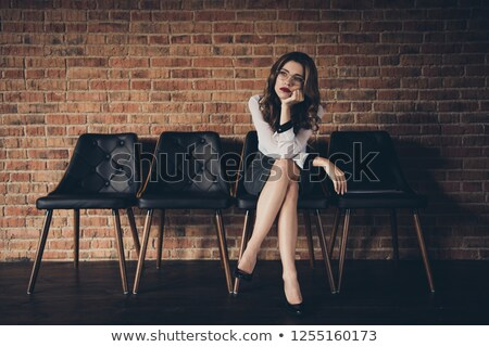 Bored at the office, nice legs Stock photo © runzelkorn