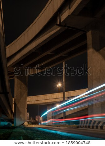 cars by night on a main road in bangkok with lights on stock photo © meinzahn