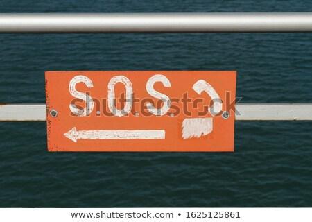 СОС телефон знак пляж белый текста Сток-фото © bigandt