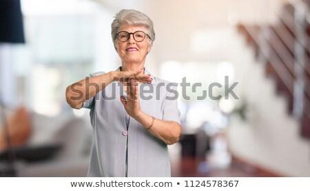 Idős nő készít idő ki jel Stock fotó © bmonteny