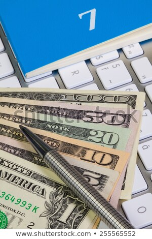 Business desk - Diary for July,US dollars,pen and keyboard Stock photo © CaptureLight