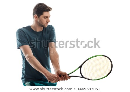 Portrait Of Young Man Playing With Tennis Racquet Stock photo © AndreyPopov