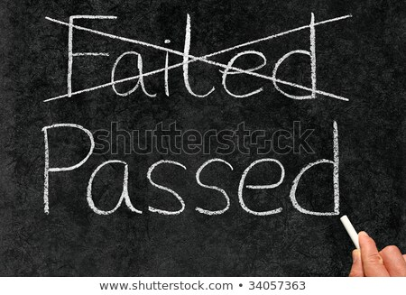Crossing out failed and writing passed on a blackboard. Stock photo © latent