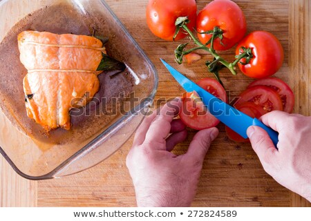 Chef slicing tomatoes to accompany salmon Stock photo © ozgur