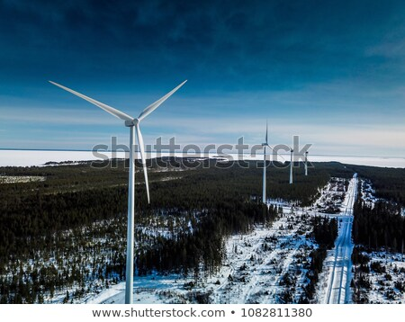 Winter Wind Turbines in a snowy field on a sunny day Stock photo © skylight