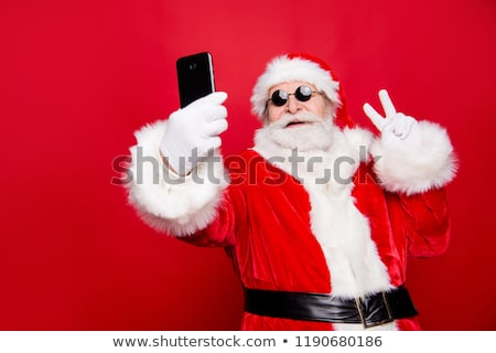 Stock photo: Santa Claus shows a smartphone