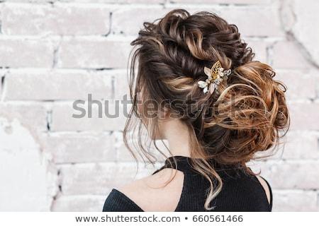 rear view of pretty blonde girl posing hands in the hair stock photo © wavebreak_media