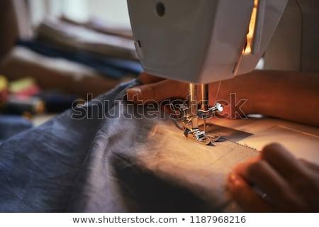 дизайнера рабочих швейные машины женщины сидят таблице Сток-фото © deandrobot