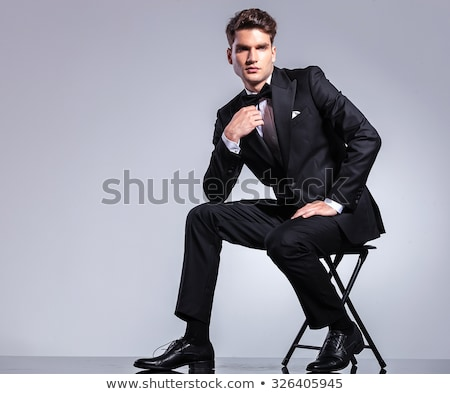 handsome business man fixing his bowtie Stock photo © feedough