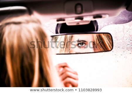 Beautiful young girl touching lips in luxury car, woman driver s Stock photo © Victoria_Andreas