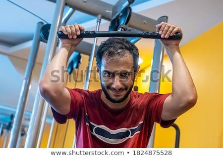 hombre · formación · aparato · sonrisa · salud · gimnasio - foto stock © Paha_L