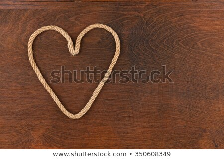 Symbolic heart made of rope lying on a wooden surface Stock photo © alekleks