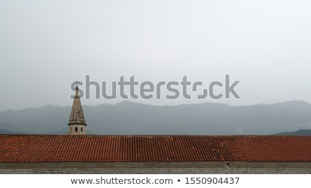 Old church with high bell tower in Budva Stock photo © Steffus